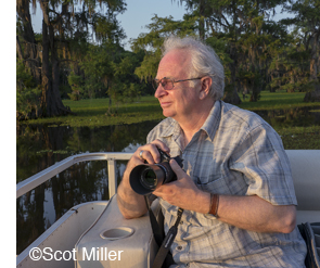 Dan Burkholder with OM-D camewra at Caddo Lake, photo by Scot Miller
